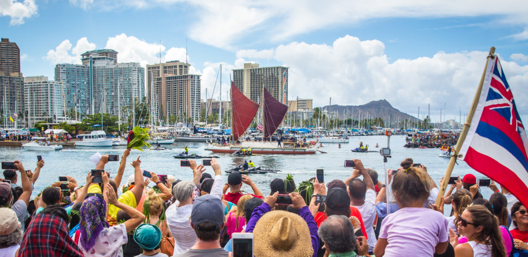 Photo: People gather at the Hōkūle'a's historic homecoming